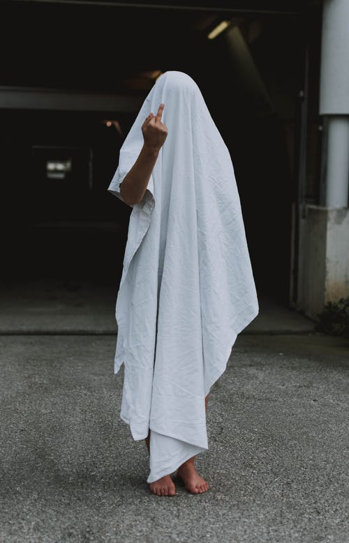 Person Covered by White Cloth