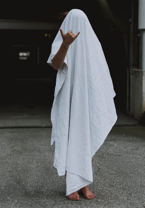 Person Covered with White Towel Close-up Photography