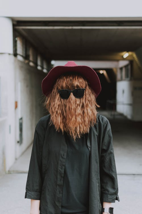 Person's Face Covered with Hair Wearing Sunglasses