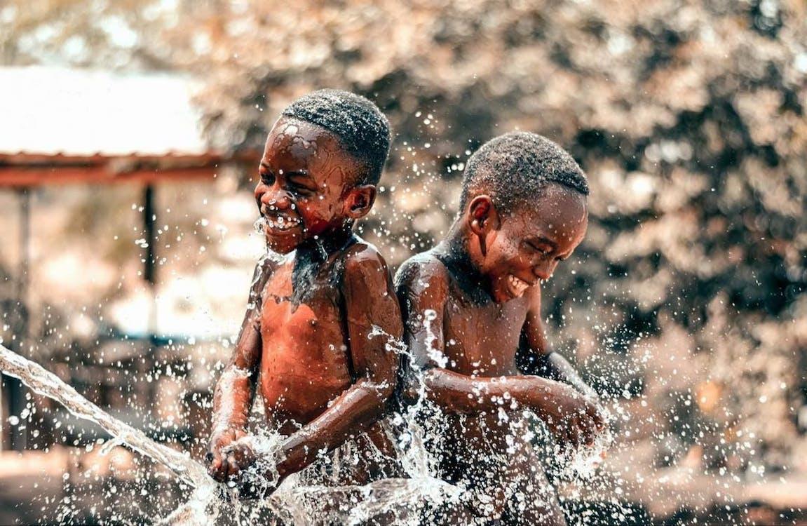 Two Boys Taking Bath Outside