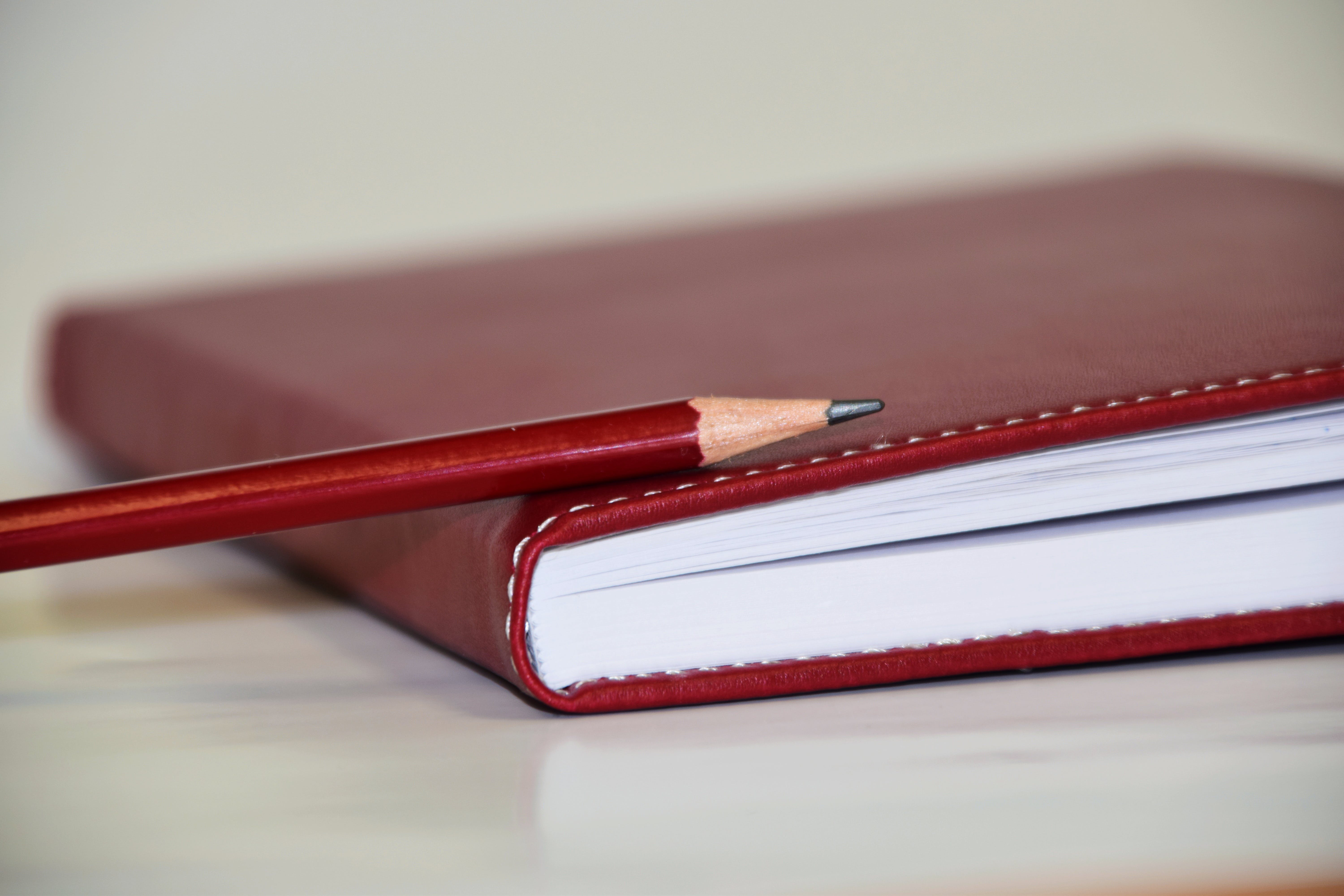 Free stock photo of red, notebook, pen, pencil