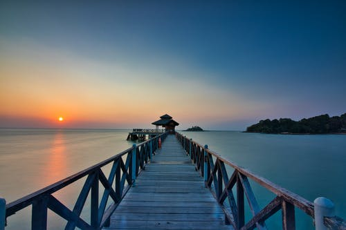 Scenic Photo Of Wooden Dock During Dawn