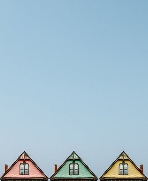Three Pink, Green, and Yellow Houses