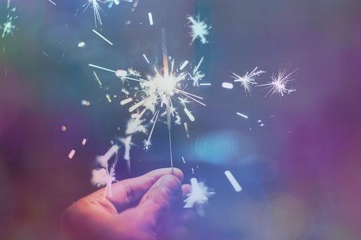 Free stock photo of hand, sparkler, celebration, illuminated