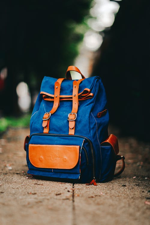 Blue and Brown Backpack  on the Ground