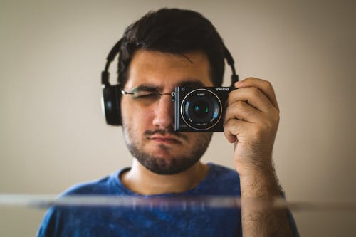 Free stock photo of dslr, headphone, mirror