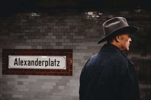 Back View Of Man Wearing Cowboy Hat and Black Coat