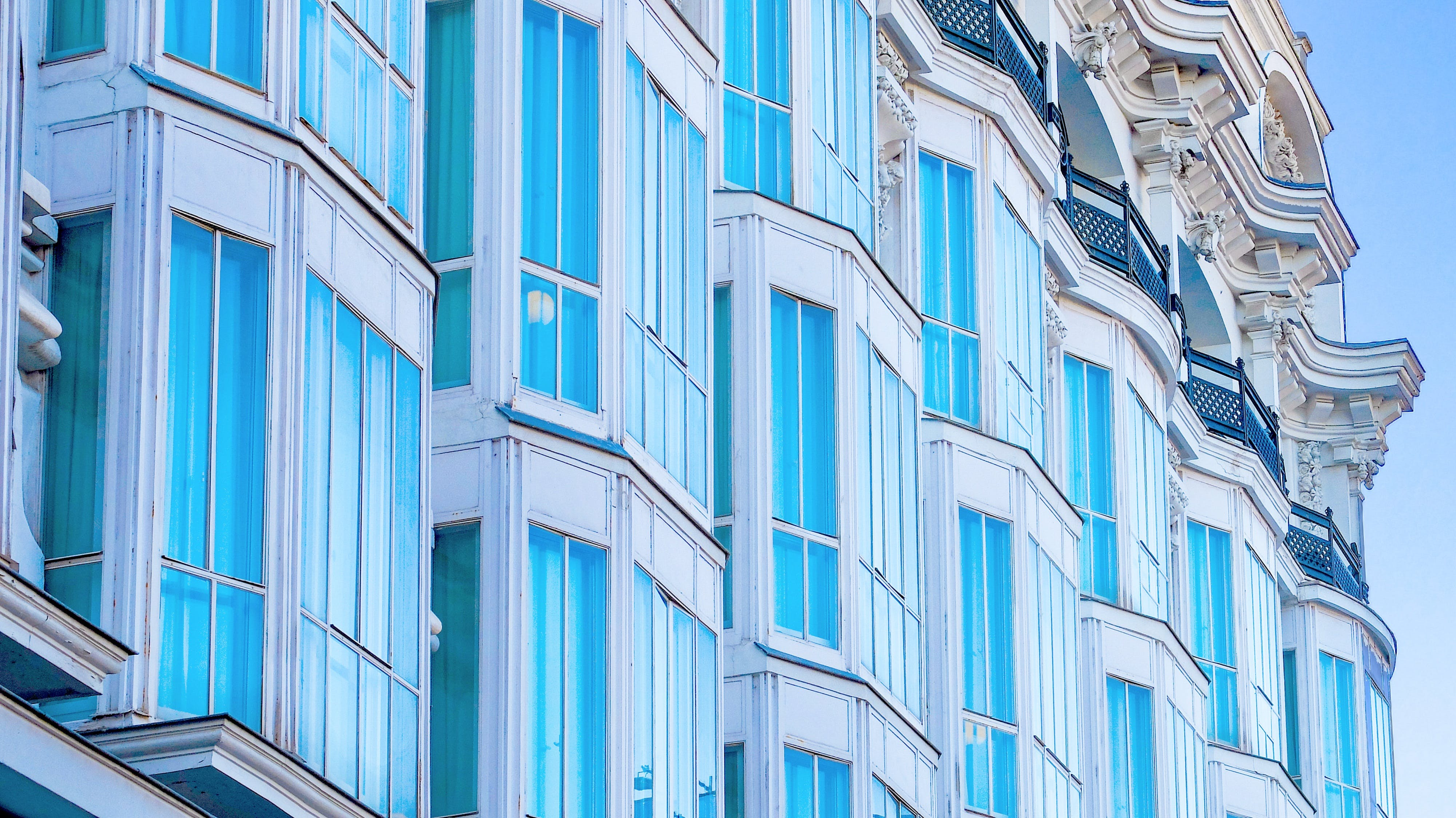 Building With Blue Curtains
