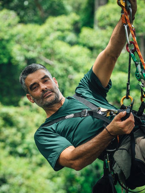 Man In Green T-shirt With Safety Harness