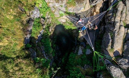 People on Hanging Net