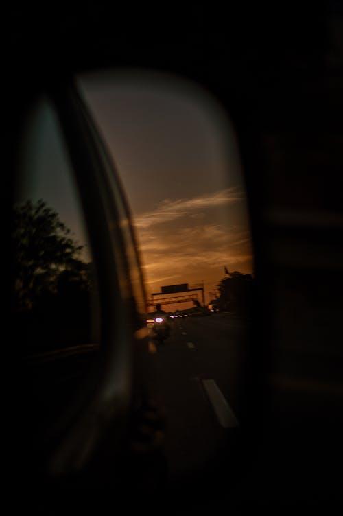 Безкоштовне стокове фото на тему «віддзеркалення, дорога, Захід сонця»