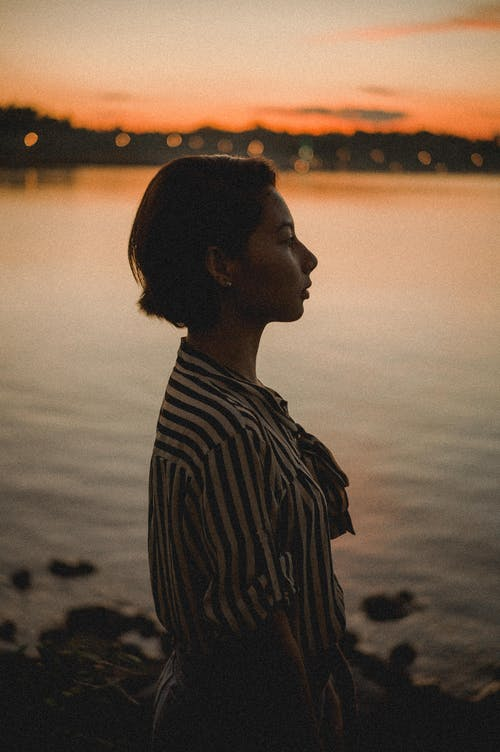 Side View Photo Of Woman During Dawn