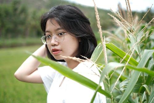 Free stock photo of Asian, cute, cute girl, green