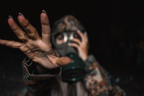 Free stock photo of focus, gas mask, hand, military