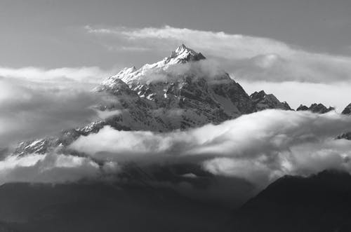Monochrome Photo Of Snow Capped Mountains During Daytime