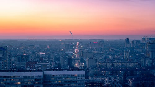 Photo Of City During Dawn