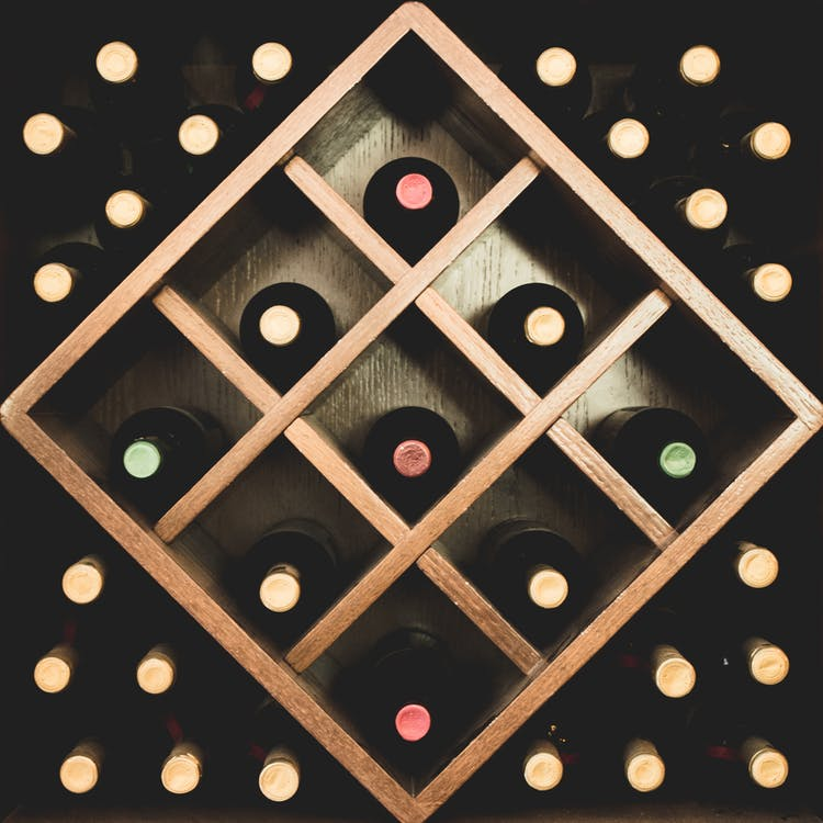 Close-up Photo of Brown Wine Rack