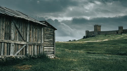 Gray Wooden Barn Under Cloudy Sky