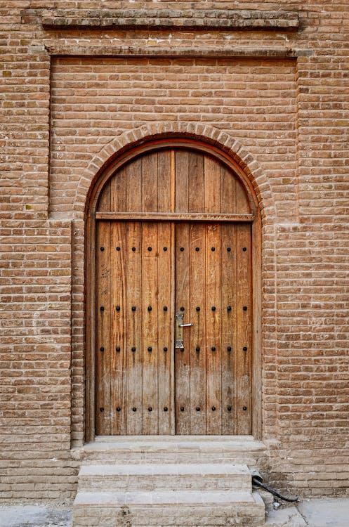 Wooden Door Of A Bricked Wall