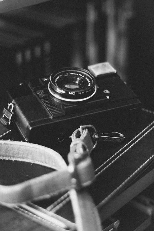 Gray-scale Photo of An Analog Camera