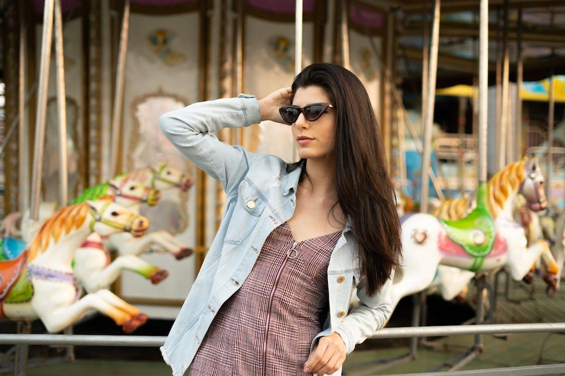 Woman Standing Near Carousel