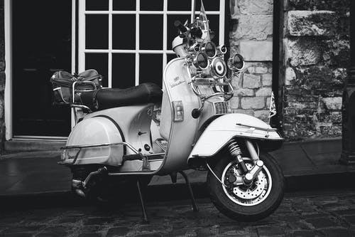 Grayscale Photography Of Motor Scooter