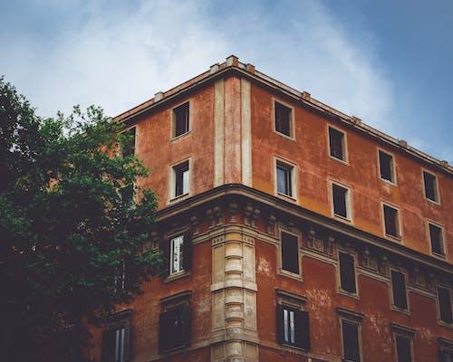 Orange Concrete Building during Day