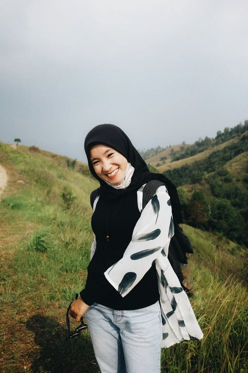Photo of Smiling Woman in Black Hijab Posing