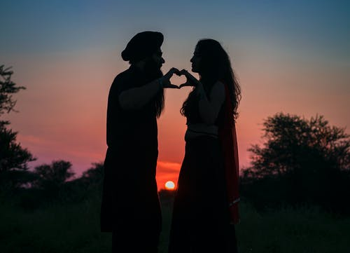 Silhouette Photo of Couple Making a Heart Shape