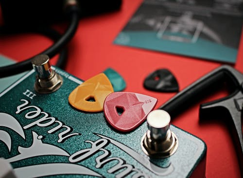 Two Guitar Picks on Guitar Pedal
