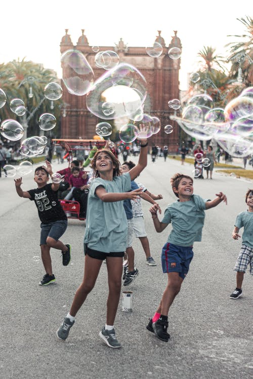 Children Playing Bubbles