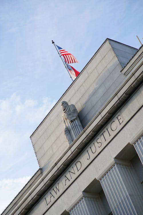 Free stock photo of American flag, building, courts, flag