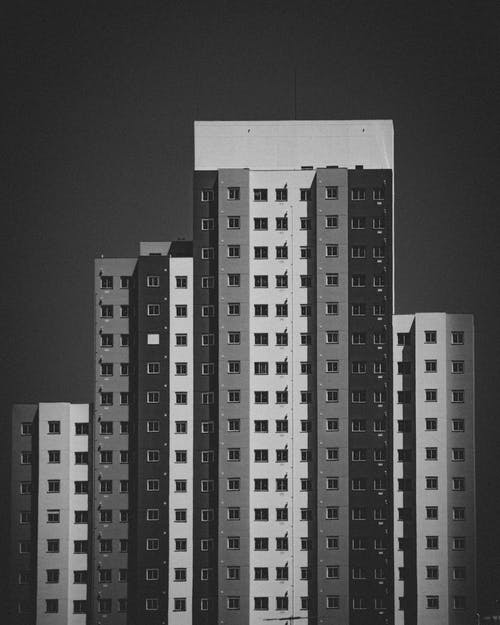 Grayscale Photo of High-rise Buildings