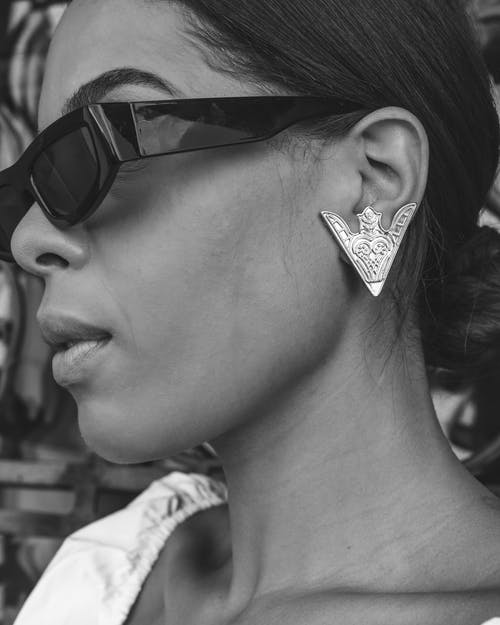Grayscale Of A Woman Wears Sunglasses and Earrings