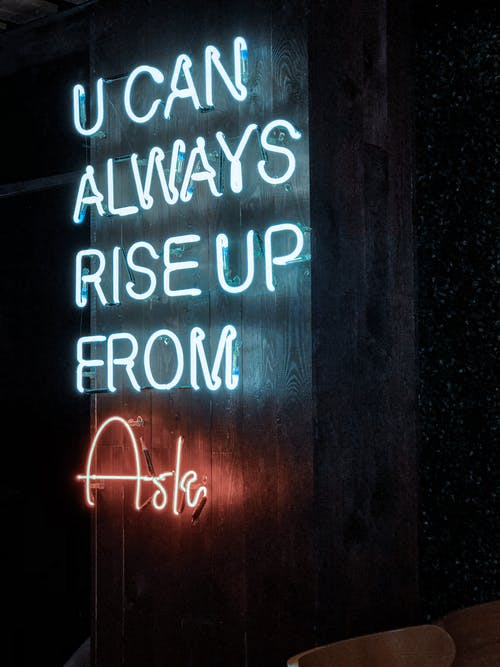 A Neon Lighted Statement Of Words
