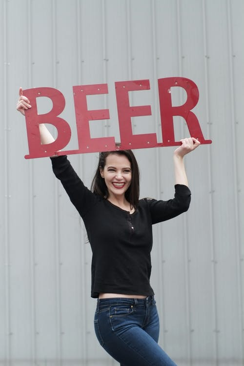 Woman Lifting Beer Signage