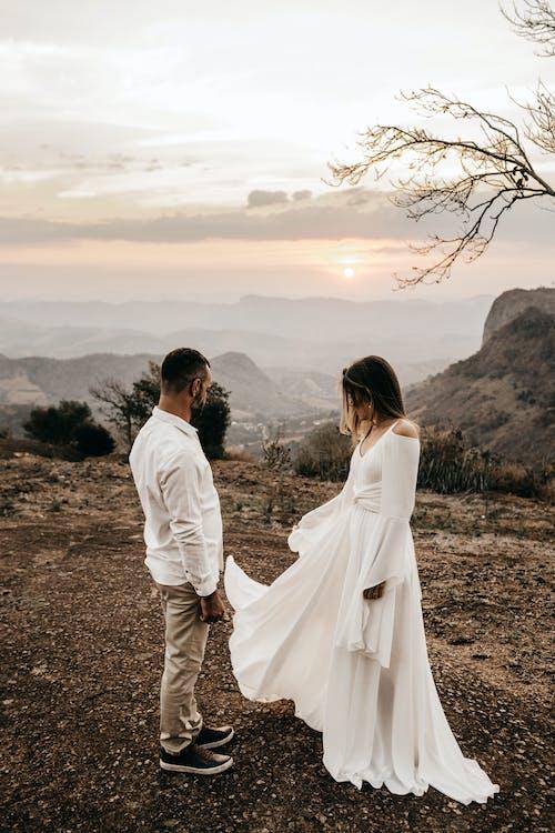 A Couple Wearing White Dress