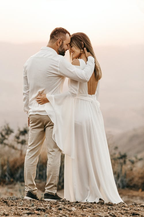 Man and Woman in White Dress and Suit