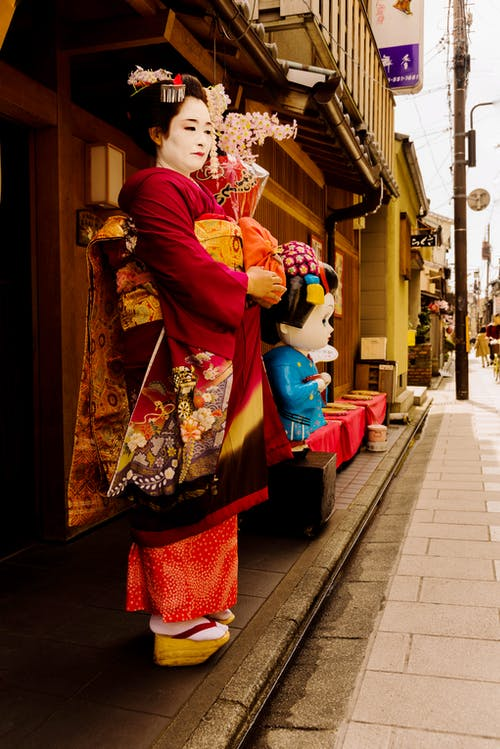 Photo Of Woman Wearing Red Kimono Standing On Street