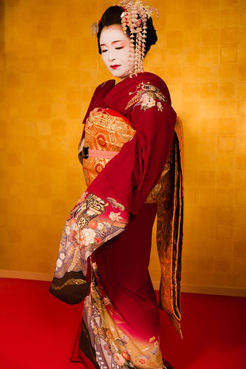 Woman Wearing Red And Gold Kimono