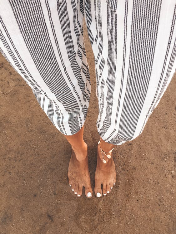 Person Wearing White and Grey Striped-up Pants