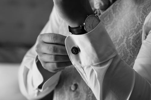 Grayscale Photo of Person Wearing Wristwatch