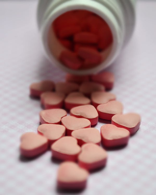 Selective-Focus Photo Of Pink Tablets