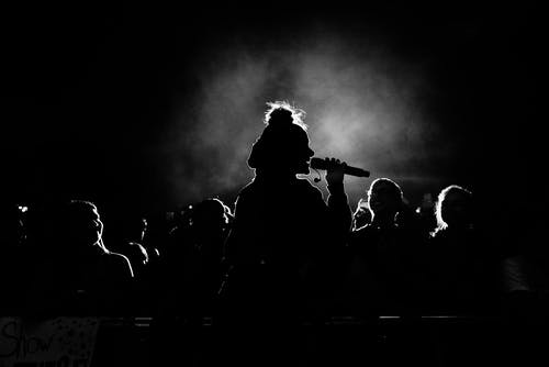 Monochrome Photo of Person Singing
