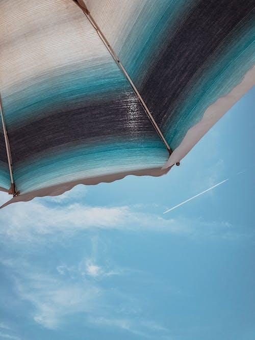 Black, Blue and White Umbrella Under Blue Sky