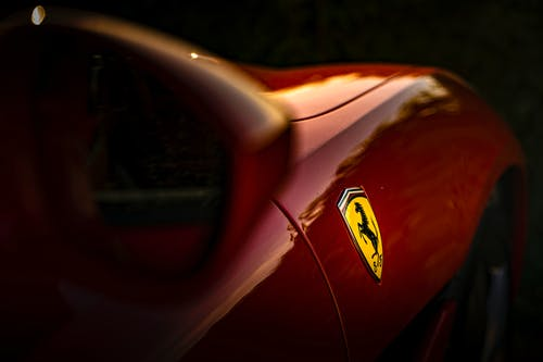 Selective Focus Photo of Ferrari Emblem