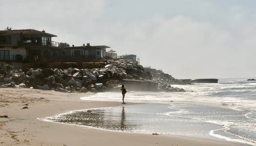 Photos gratuites de bord de mer, enceinte, femme, horizon