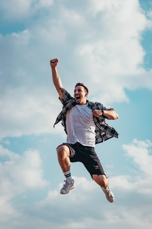A happy man jumping.   Photo: Pexels