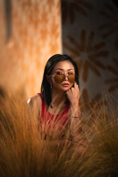 Woman in Red Top Wearing Sunglasses