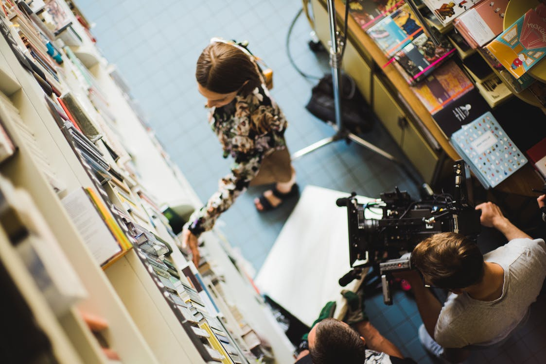 Filming a Woman at Library
